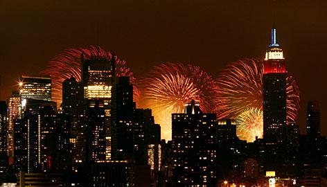 new york city at night skyline. Fireworks over New York City