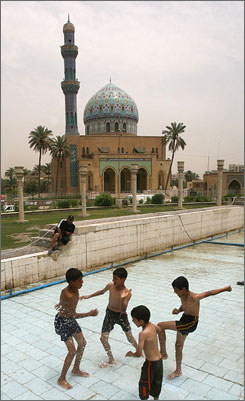 "Postcard view:Boys play in May in Firdos Square near the 14th of Ramadan Mosque, from which Sunni faithful are increasingly shying away. ""Nobody comes at the dawn prayer,"" Imam Omar al Saedi says."