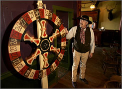 Now that Kansas lawmakers have allowed casinos in Ford County, Dodge City's civic leaders expect this replica wheel of fortune at the Long Branch Saloon won't be the only gambling device in town.