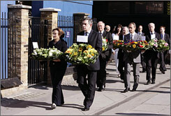 Britain's Prime Minister Gordon Brown prepares to lay flowers during a commemoration at King's Cross railway station in London.