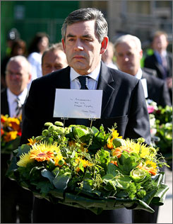 Britain's Prime Minister Gordon Brown arrives to lay a bouquet of flowers in a memorial garden outside King's Cross Station in London to mark the second anniversary of the London bombings, Saturday July 7, 2007. Brown encouraged greater communication between European countries in anti-terrorism efforts.