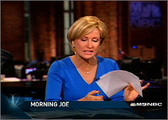 "In this photo from video, Mika Brzezinski attempts to burn a news script about Paris Hilton getting out of jail, on the ""Morning Joe"" show on June 26, 2007."