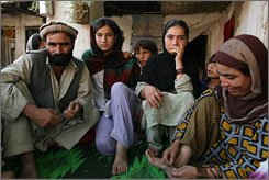 Nazir Ahmad said he was forced to pay a debt of less than $200 by betrothing his teenage daughter Malia, third from left. From left to right Malia's father, sister, Malia, and her mother, during an interview with Associated Press in their home in Jalalabad, Afghanistan, Sunday, July 1, 2007.