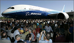 Thousands of employees, airline executives and dignitaries turned out for the unveiling of Boeing's first 787 Dreamliner, which is set to burn less fuel and offer more comforts.