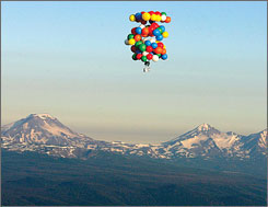 Balloons suspend Kent Couch in a lawn chair as he floats in the skies near Bend, Ore., Saturday. Couch, on his way to Idaho, carried a global positioning system device, a two-way radio, a digital camcorder and a cell phone.