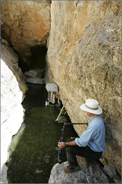 Recovery coordinator Paul Barrett visits the small thermal pool that is the only natural habitat for the Devils Hole pupfish.
