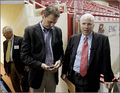 Sen. John McCain, R-Ariz., stands with political adviser John Weaver, center, before a Boston speaking engagement. Weaver and campaign manager Terry Nelson have left McCain's campaign.
