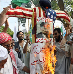 Activists torch an effigy of President Pervez Musharraf with a U.S. flag during an anti-Musharraf protest rally in Islamabad on Friday.