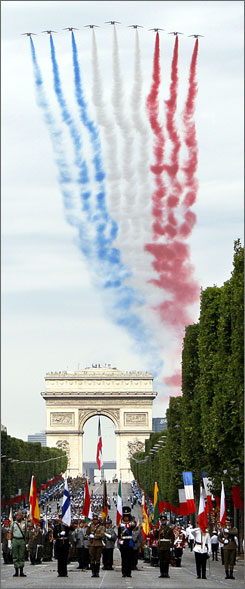 Alphajets of the Patrouille de France flew over the Arc de Triomphe during Saturday's festivities in Paris.