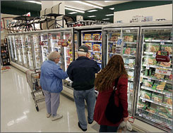 Shoppers look through the frozen foods section at the Acme supermarket store in Lawrenceville, N.J. U.S. shoppers may be forgiven if they are becoming leery of foreign-made goods and are trying to fill their grocery carts with foods free of ingredients from other countries. The trouble is, that may be almost impossible.