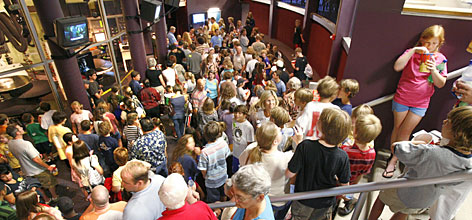 Harry Potter releases and celebrations draw crowds of fans willing to wait hours to see a movie or read a book, like these fans waiting in line to see the latest film in Richmond, Va.