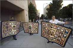 Members of the Survivors Network of those Abused by Priests, SNAP, protest outside Cathedral of Our Lady of the Angels, seat of the Archdiocese of Los Angeles, in September.