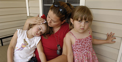 Fatherless family:Rachel Kincaid, widow of Aaron Kincaid, with her daughters Kennedy, 6, right, and Abigail, 4, at their home in Monroe, Ga. Aaron's armored Humvee proved insufficient against the blast of a makeshift bomb that killed him in October 2006.