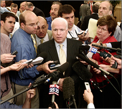 U.S. Sen. and presidential candidate John McCain speaks with the media following a major policy address, Friday in Concord, N.H.