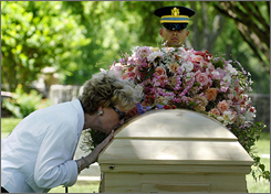 An unidentified mourner kisses Lady Bird Johnson's casket Sunday after Johnson's private burial service at the family cemetery on the Johnson ranch near Stonewall, Texas.