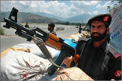 Pakistani paramilitary troops take up position near Matta in North West Frontier Province, where pro-Taliban militants are known to operate along the border with Afghanistan, July 16, 2007.