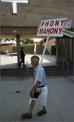 Donald Kohles pickets Los Angeles' Our Lady of the Angels cathedral Sunday after the announcement that the Roman Catholic Archdiocese of Los Angeles was to settle its clergy abuse cases for $660 million, the largest payout to date in the sexual abuse scandal.