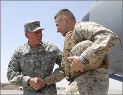 Army Gen. David Petraeus, commander, multi-national Forces in Iraq, left, greets Joint Chiefs Chairman Gen. Peter Pace Monday in Baghdad. Pace is in Iraq to meet leadership, visit troops and to assess operations.