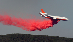 Before an accident grounded it last month, a DC-10 drops fire retardant last September near an Ojai, Calif., wildfire.