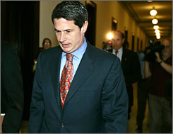 Sen. David Vitter, R-La., walks, with reporters in tow, down the corridor of the Russell Senate Office Building on Capitol Hill in Washington Tuesday.