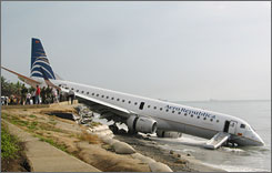 A Brazilian-made Embraer 190 plane operated by Aero Republica skidded off the wet runway of Simon Bolivar airport in Santa Marta, Colombia and crashed into the Caribbean Sea, injuring at least seven of the 54 people onboard the same day that a Brazilian jet crashed into a gas station in Sao Paolo, Brazil.