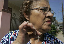 "A small reminder: Katrina survivor Rowena Duplessis, 67, says that despite moments of doubt and anger,  her faith in God remains unshaken: ""If he gave his son, then I can?t complain that mine is gone,"" Duplessis says."