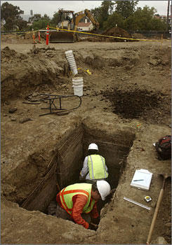 Archaeologists Val Kirstine, front, and Marisa Solorzano work on a dig Monday, in an area that was the women's privy at the site of the first courthouse in the city of Ventura, Calif., near downtown.