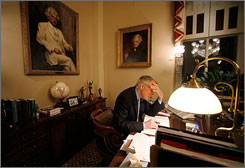 Senate Majority Leader Harry Reid sits at his desk in his office in Washington, D.C. The Senate held an all-night debate before today's vote on an amendment to the Defense Authorization Bill, which will require the start of withdrawing U.S. troops from Iraq in 120 days.
