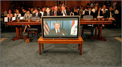 U.S. Ambassador to Iraq Ryan Crocker testifies from Baghdad via video conference during a Senate Foreign Relations Committee hearing Thursday in Washington.