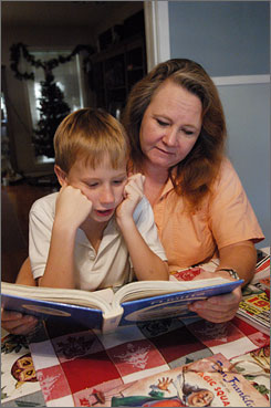 Sean Smith and his mother, Kathye, read at their home in Pasadena, Texas. Sean has mild attention deficit hyperactivity disorder and has received group counseling. A new study suggests that kids with ADHD who receive some form of treatment will improve.