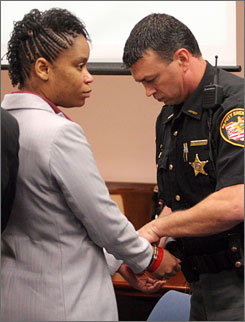 China Arnold, who is accused of killing her month-old daughter by putting her in a microwave oven, placed back in handcuffs during a recess in her pre-trial hearing at Montgomery County Common Pleas Court in Dayton, Ohio, on Thursday.