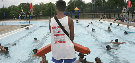 Lifeguard Illyas Hodrick watches over the Pleasant Ridge Pool in Cincinnati, a pool lucky to have found enough lifeguards to stay open.