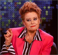 Tammy Faye Messner gestures during an interview with talk show host Larry King, on CNN's Larry King Live in Los Angeles in this March 18, 2004, file photo.