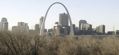The St. Louis Gateway Arch is seen from the East St. Louis, Ill., side of the Mississippi River, against the St. Louis skyline. A power outage in the south leg of the national monument trapped people inside the south leg and at the top of the arch Saturday.