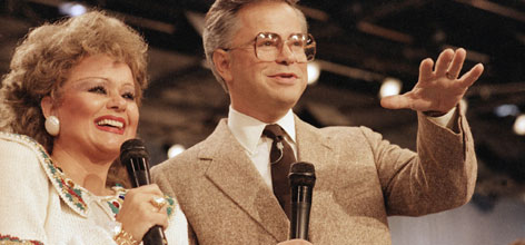 Tammy Faye and her then-husband, television evangelist Jim Bakker, talk to their TV audience at their PTL ministry near Fort Mill, S.C., in this Aug. 20, 1986 file photo. Messner, who helped him build a multimillion-dollar evangelism empire and then saw it collapse in disgrace, died Friday. She was 65.