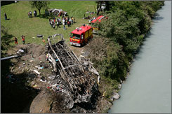 Twenty-six people were killed when a bus that was transporting Polish pilgrims from a holy site in the French Alps plunged off a steep mountain road, crashed into a river bank and burst into flames Sunday, authorities said.