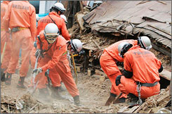 Crews search for survivors at a collapsed house in Kashiwazaki on Tuesday, the day after a powerful quake struck Japan's west coast, killing 10, injuring more than 1,000, and damaging a nuclear power plant.
