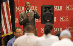 Barack Obama answers questions from the audience during a townhall meeting at the National Council of La Raza conference in Miami Beach.