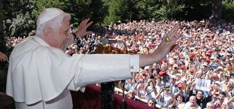 Pope Benedict XVI waves during his Angelus prayer at Mirabello castle in Lorenzago di Cadore, northern Italy, on July 15. Benedict has been stepping up his peace appeals while on vacation.