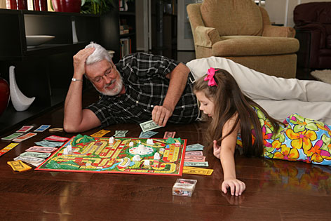"Keeping active: Richard Taylor plays a game with his granddaughter, Christina Hakala, 7. ""Over time, people with Alzheimer's just give up,"" he says."