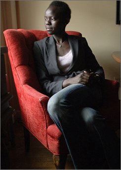 "A tragic childhood: Aduei Riak, 23, is shown in her Boston-area apartment. As a young girl in Africa,  she was separated from her family while fleeing violence and ""was pretty much on my own"" at age 6."