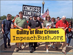 Peace activist Cindy Sheehan, second from right, was arrested Monday at the Capitol for disorderly conduct, after she led a march of 200 protesters from Arlington National Cemetery to call for the impeachment of President Bush and Vice President Cheney.