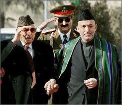 Mohammed Zahir Shah, left, attended the Dec. 7, 2004 inauguration ceremony of Afghanistan President Hamid Karzai, right.
