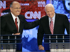 Republican presidential hopefuls former New York City Mayor Rudy Giuliani, left, and Sen. John McCain, R-Ariz.,share a laugh during the Republican presidential primary debate hosted by Saint Anselm College in Manchester, N.H., June 5.