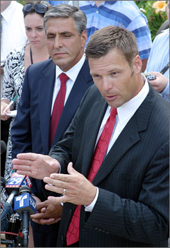 Hazleton city attorney Kris Kobach, right, speaks during a news conference at City Hall, in Hazleton, Pa., Thursday, July 26, 2007, as Mayor Lou Barletta looks on.