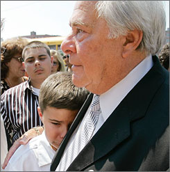 Joseph Salvati hugs his grandson Michael Salvati, 10, as they stand outside federal court in Boston. To protect an informant, the FBI withheld evidence of Salvati and three other mens' innocence, condemning them to three decades in prison until their sentence was commuted in 2001.