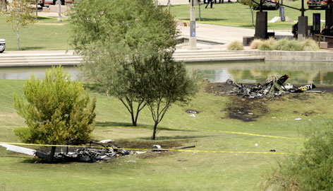 Two news helicopter crash sites are shown in Indian Steele Park Friday in Phoenix. The collision happened as the two choppers, one from KNXV, the other from KTVK, broadcast coverage of police pursuing a truck.