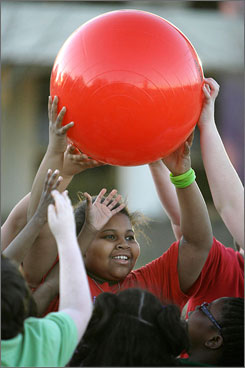 Alana Washington, 9, catches a ball while playing kickball during a program at Dallas' Children's Medical Center to encourage families' involvement in their overweight children's weight loss.