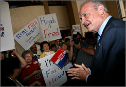 Undeclared presidential candidate Fred Thompson greets supporters at Dallas Love Field Airport on July 25 in Dallas.