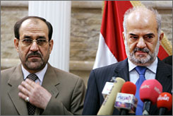 Prime Minister Nouri al-Maliki, left, appears with outgoing prime minister Ibrahim al-Jaafari at a news conference in this April 2006 file photo in Baghdad. Jaafari leads the challenge to oust Maliki as Iraq's leader.
